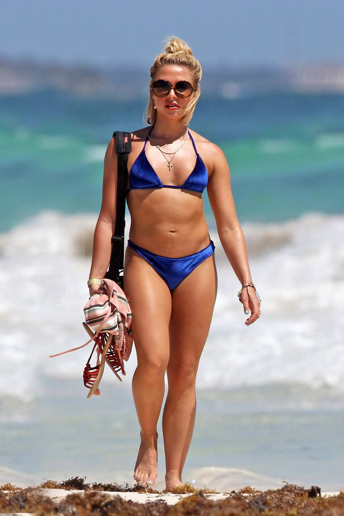 Gabby Allen soaks up the sun in a blue bikini while enjoying a beach day with friends in Tulum, Mexico