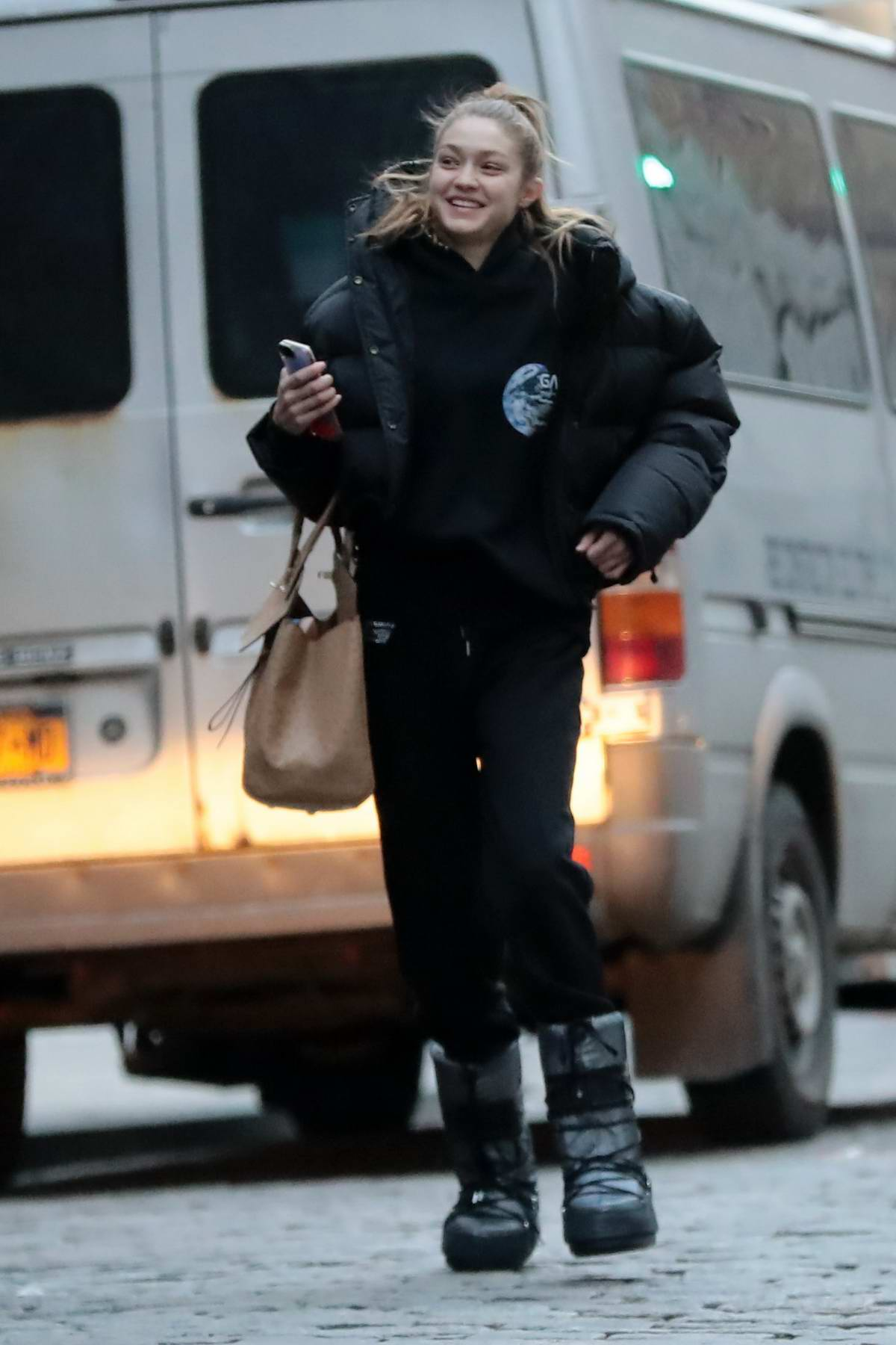 Gigi Hadid is all smiles as she leaves a photoshoot in New York City