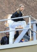 Gigi Hadid spotted on a rooftop during a photoshoot for Maybelline in New York City