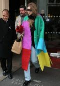 Gigi Hadid wears a multi-colored coat as she leaves Le Royal Monceau Hotel in Paris, France
