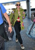 Gwen Stefani keeps it trendy as she arrives to catch a flight out of LAX airport in Los Angeles