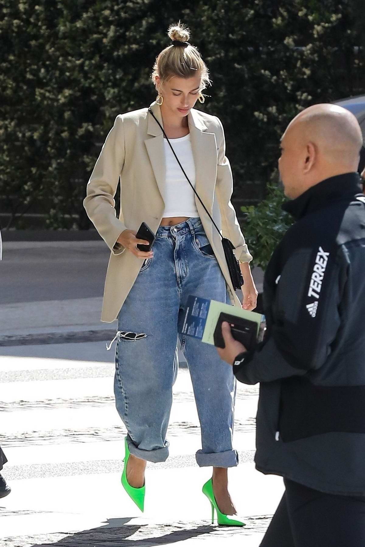 Hailey Baldwin Bieber is street chic as she drops off her car at Valet at the Waldorf Hotel in Beverly Hills, Los Angeles