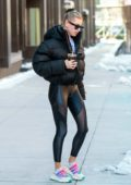 Hailey Baldwin Bieber rocks a black puffer jacket with matching leggings as she heads for her workout in Brooklyn, New York City