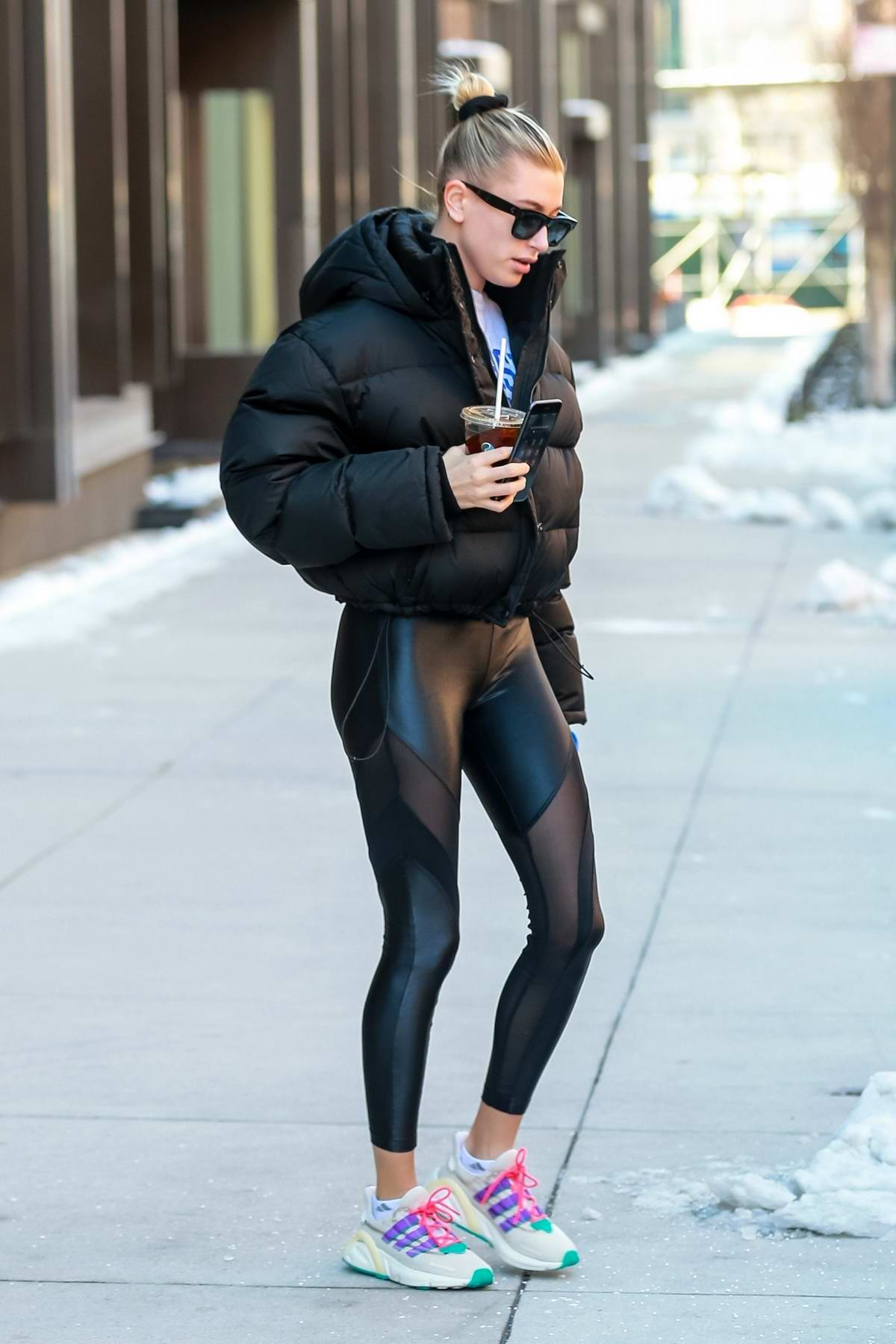 3fa4ad505cda6a Hailey Baldwin Bieber rocks a black puffer jacket with matching leggings as  she heads for her workout in Brooklyn, New York City