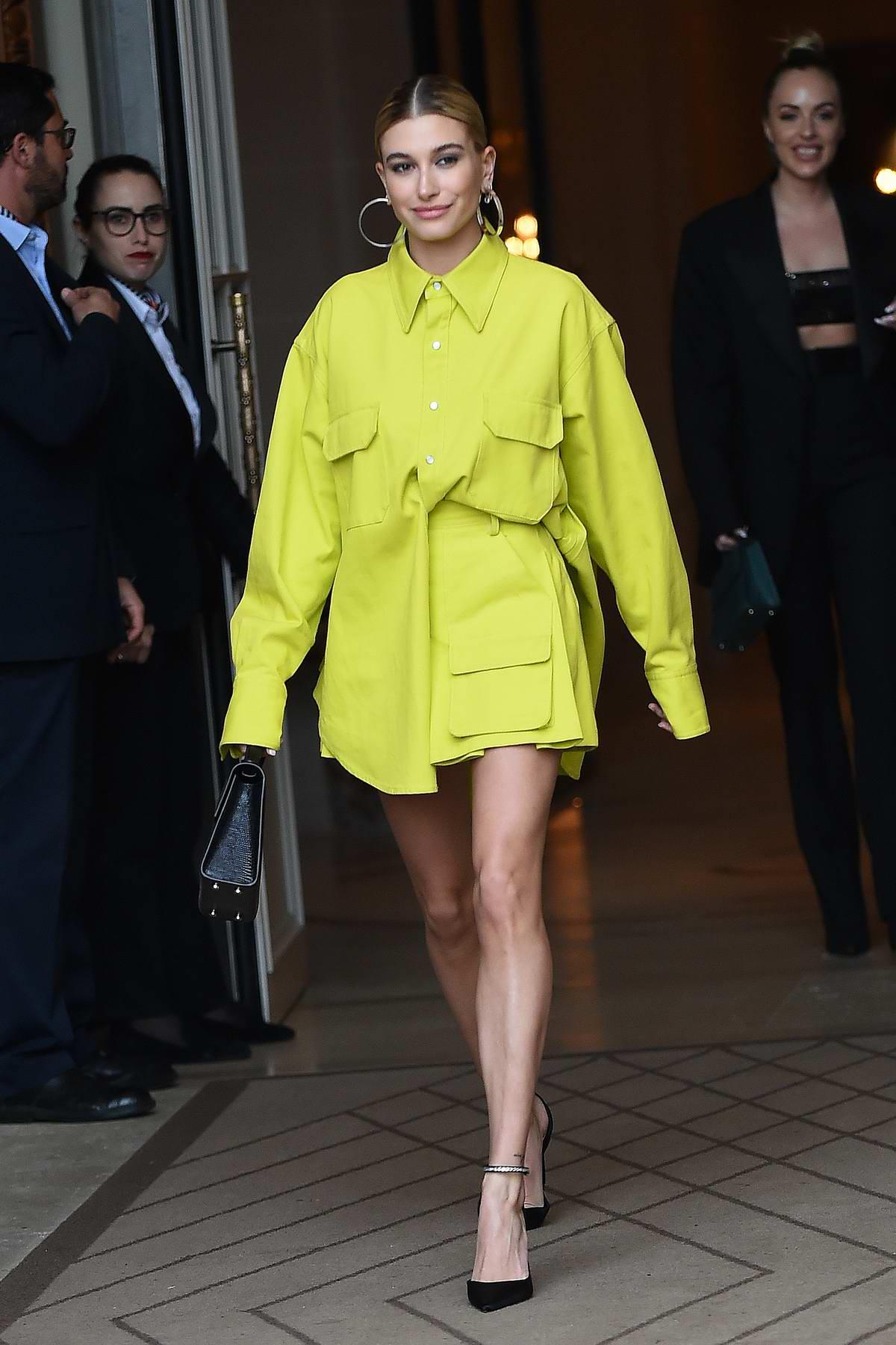 Hailey Baldwin Bieber rocks a short bright green dress while visiting Balmain in Paris, France