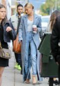 Hailey Baldwin looks super stylish in a floor-length blue coat with a white top and blue jeans while out shopping in Malibu, California