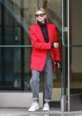 Hailey Baldwin puts on a stylish display in a red blazer, black turtleneck and rolled up jeans as she steps out to grab coffee for two in New York City
