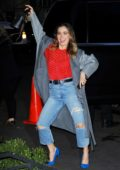 Haley Lu Richardson puts on a show for the cameras as she returns to her hotel in New York City