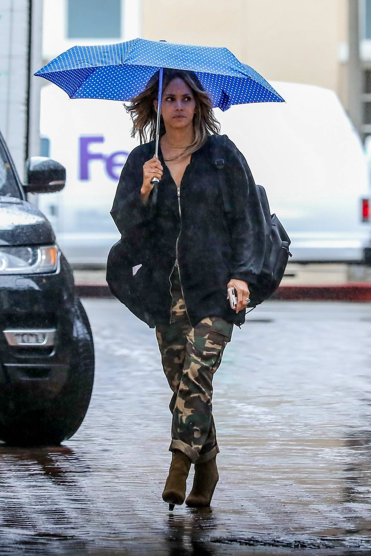Halle Berry steps out in the rain for a meeting at United Talent Agency in Beverly Hills, Los Angeles