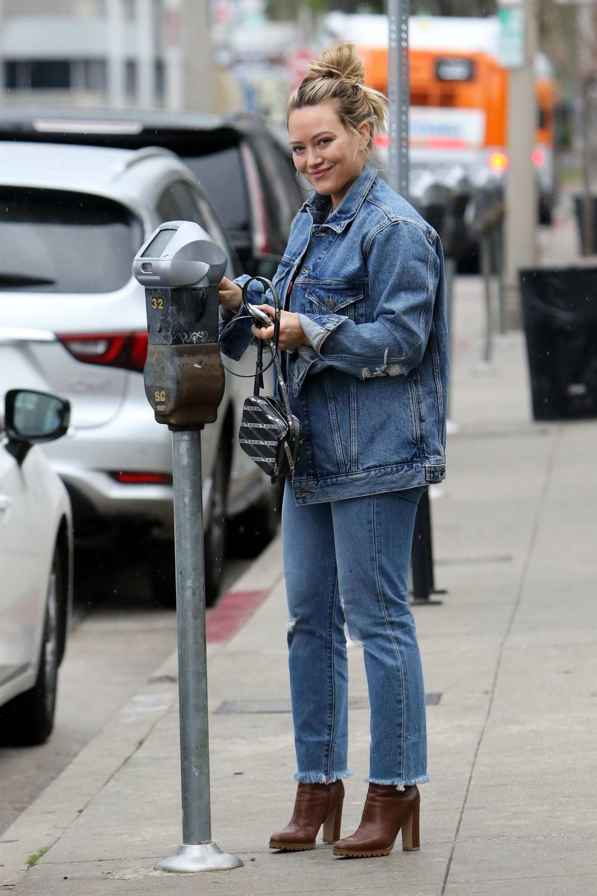 Hilary Duff rocks double denim as she steps out for coffee at Joan's On Third in Los Angeles