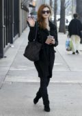 India Eisley waves for the camera while out shopping in in Los Angeles