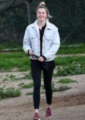 Ireland Baldwin gets playful with her dogs at a Hollywood Hills dog park in Los Angeles
