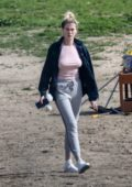 Ireland Baldwin keeps it casual with a light pink top and grey sweatpants as she takes her Husky to the dog park in Santa Monica, California
