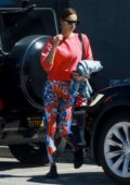 Irina Shayk stands out in a pair of colorful leggings and red sweatshirt as she leaves the gym in Los Angeles