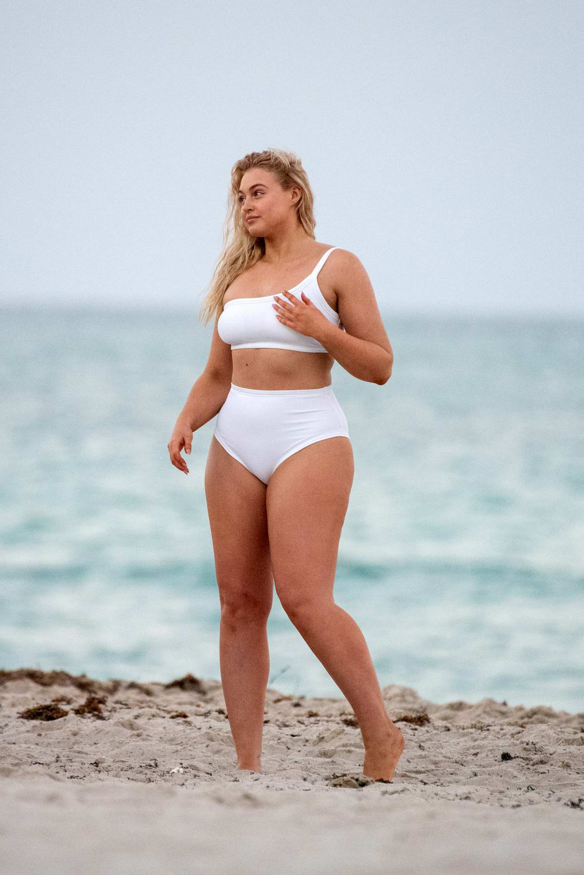 Iskra Lawrence sports a white bikini during a night photoshoot in Miami Beach, Florida