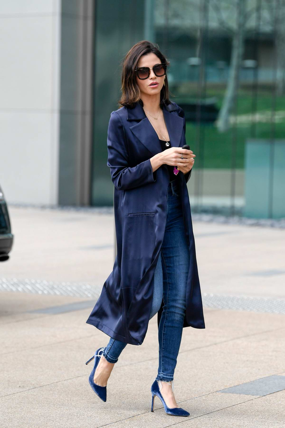Jenna Dewan spotted in a long navy blue coat, black top, jeans with matching blue heels while arriving at an office building in Los Angeles