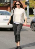 Jennifer Garner wears a white sweater with black and white striped pants to lunch with friends in Brentwood, Los Angeles