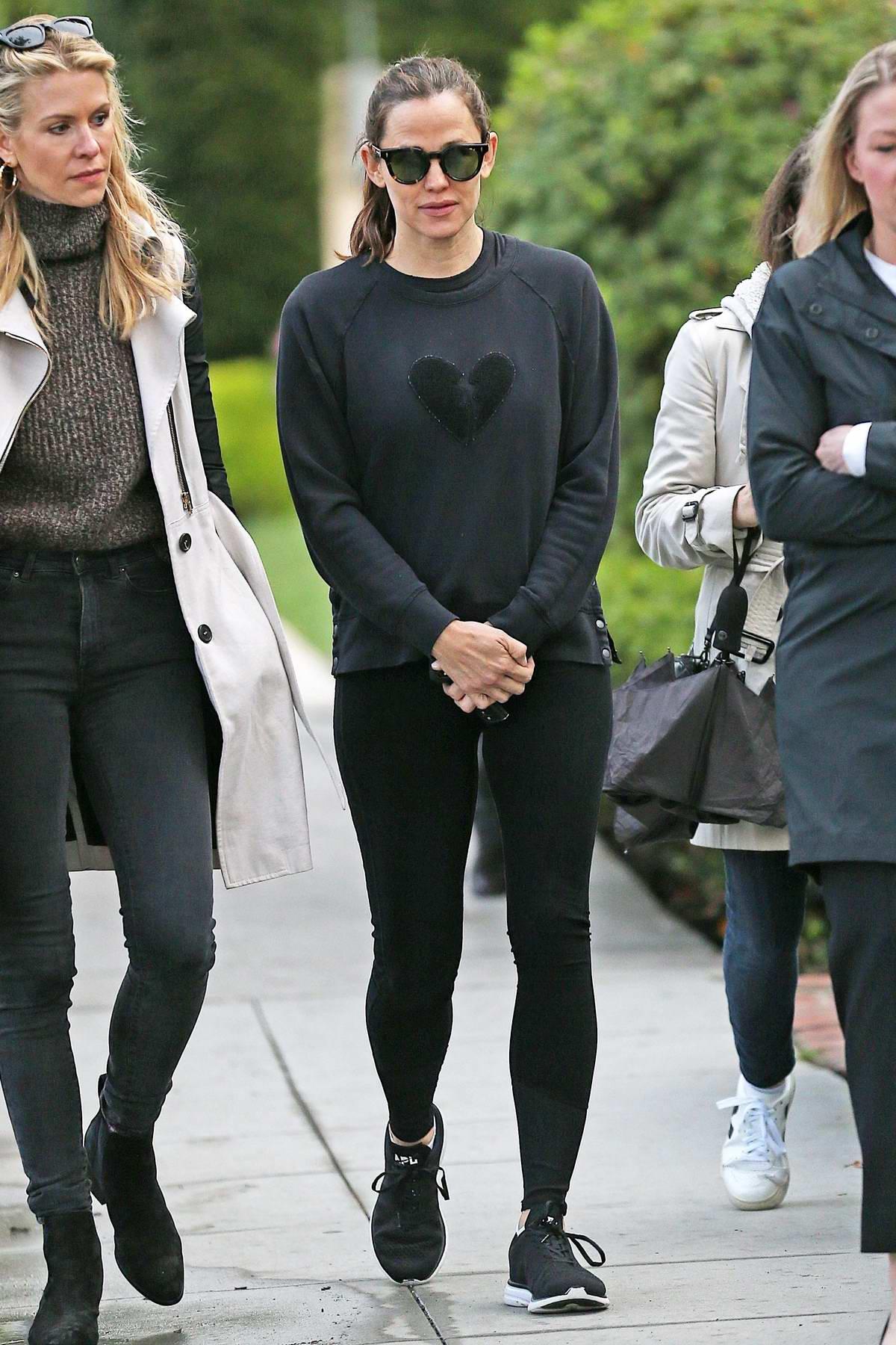 Jennifer Garner wears broken heart jumper and black leggings while out for a walk with her friends in Santa Monica, California