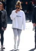 Jennifer Lopez hits the gym wearing a white Guess sweater and grey leggings in New York City