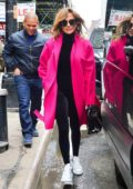 Jennifer Lopez rocks a hot pink coat as she steps out in New York City