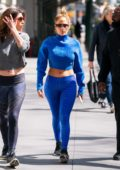 Jennifer Lopez shows off her abs in a blue crop top with matching leggings while heading to gym with her sister in New York City
