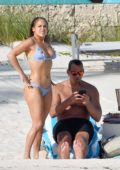 Jennifer Lopez shows off her incredible beach body in a blue bikini while catching some rays with Alex Rodriguez in The Bahamas