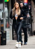 Jennifer Lopez spotted in a black hoodie and black leggings while filming her upcoming movie 'Hustlers' in New York City