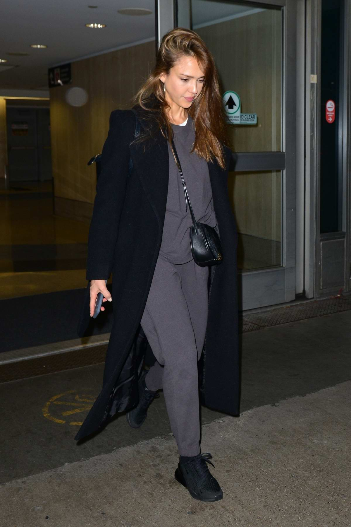 Jessica Alba jets in on a late flight as she makes her way through the LAX Airport in Los Angeles
