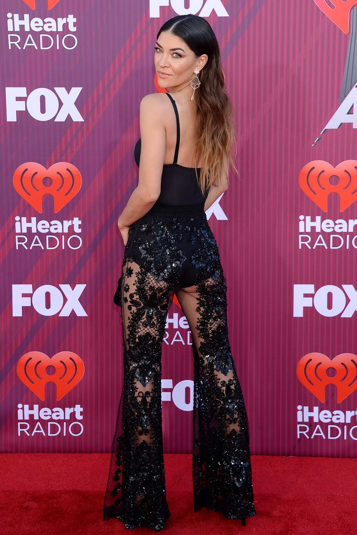 Jessica Szohr attends the 2019 iHeartRadio Music Awards at Microsoft Theater in Los Angeles
