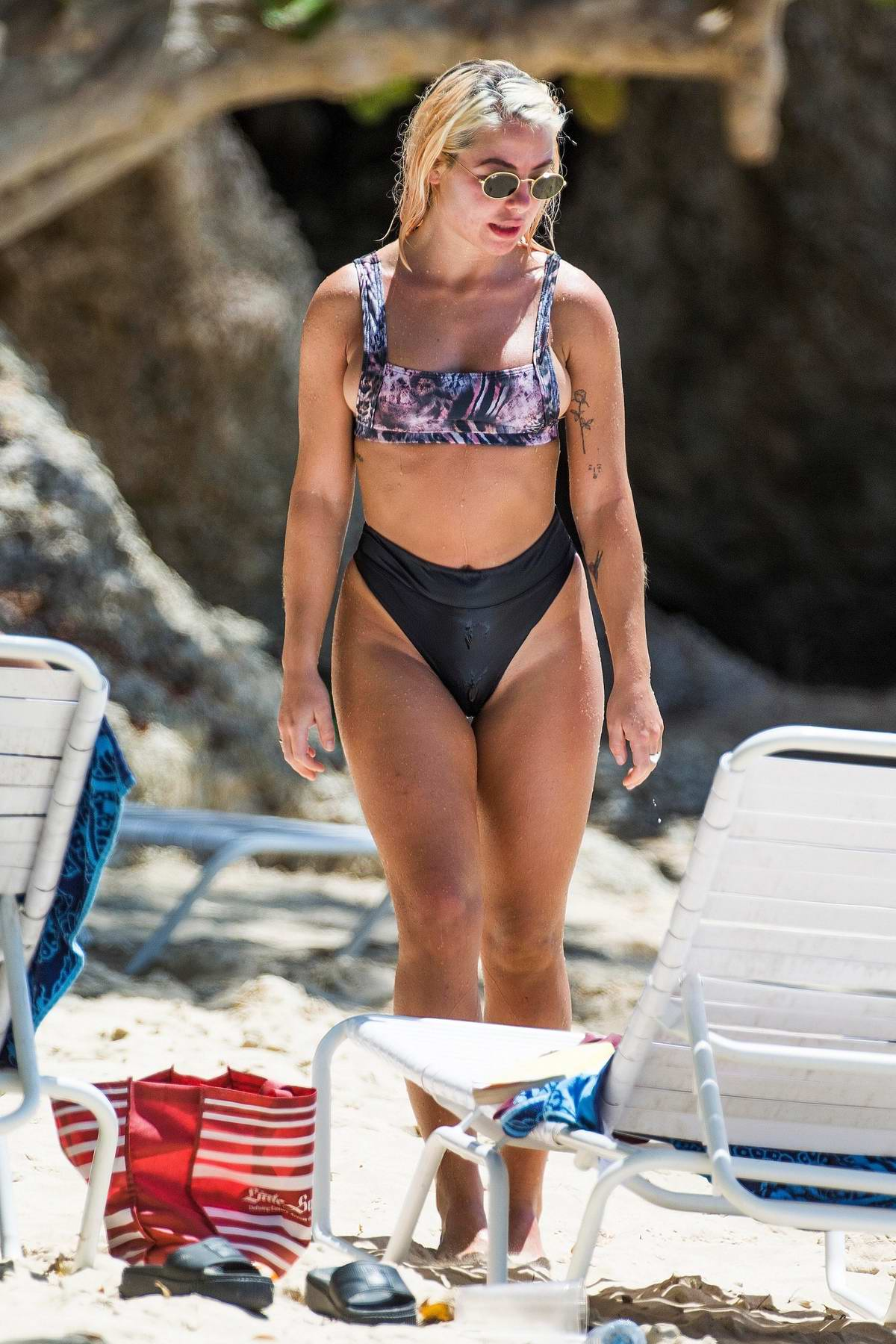 Jessica Woodley enjoys a day at the beach in a bikini while holidaying in Barbados