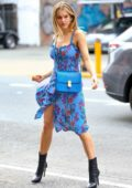 Joy Corrigan poses in a blue floral dress during a photoshoot in SoHo, New York City