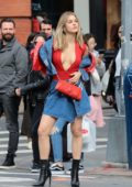 Joy Corrigan stuns in a plunging red top with a denim skirt during photoshoot in Soho, New York City