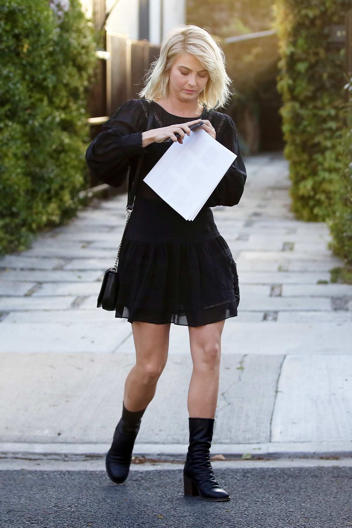 Julianne Hough get changed into a short black dress as she leaves after a business meeting in Los Angeles