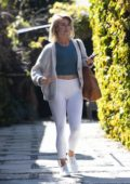 Julianne Hough rocks a grey sweater, blue top and white leggings as she leaves a friend's house in Los Angeles