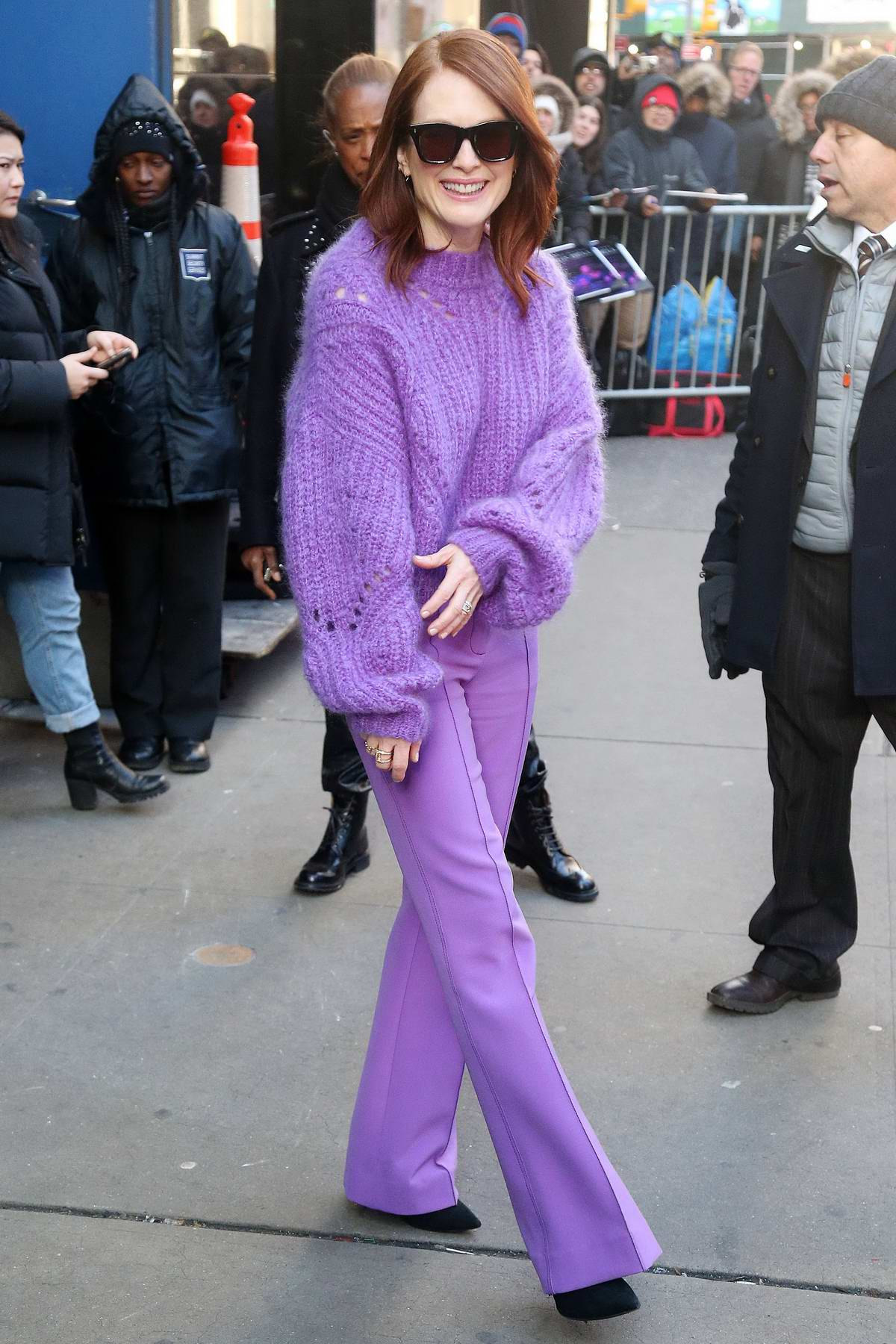 Julianne Moore wears a purple sweater with matching purple pants while visiting Good Morning America in New York City