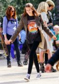 Kaia Gerber enjoys some frozen yogurt while out with a friend at Washington Square Park in New York City