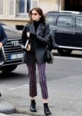 Kaia Gerber seen leaving after Givenchy fitting at Avenue Montaigne in Paris, France