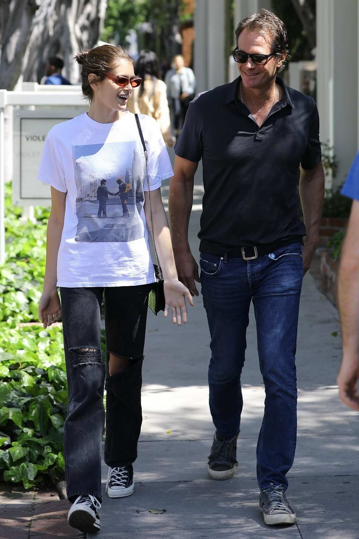Kaia Gerber steps out with dad Rande Gerber for some shopping in West Hollywoood, Los Angeles