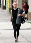 Kaley Cuoco rocks a black tank top and black leggings as she leaves a yoga class in Studio City, Los Angeles