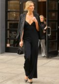Karlie Kloss cuts a clean look wearing all black as she steps out in New York City