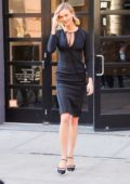 Karlie Kloss dons a form fitting black dress as she heads to Jimmy Fallon in New York City