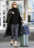 Karlie Kloss keeps it stylish with a black leather long coat with a black top and cropped jeans as she touches down at JFK Airport in New York City