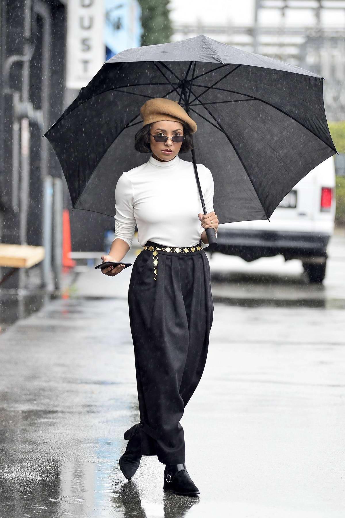 Kat Graham gets caught in the rain during a photoshoot in Los Angeles