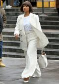 Kat Graham seen wearing a white pinstriped suit as she attends the United Nation Woman For Peace Luncheon in New York City