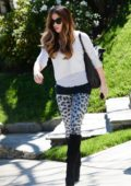Kate Beckinsale wears layered shirts paired with animal print leggings, and black knee high boots as she heads to the gym in Los Angeles