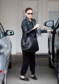 Kate Mara covers her baby bump as she leaves after workout at Ballet Bodies in West Hollywood, Los Angeles