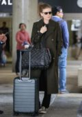 Kate Mara looks great in an olive green long coat as she arrives at LAX Airport in Los Angeles