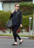 Kate Mara shows her growing baby bump as she heads out in a black leather jacket in Los Angeles