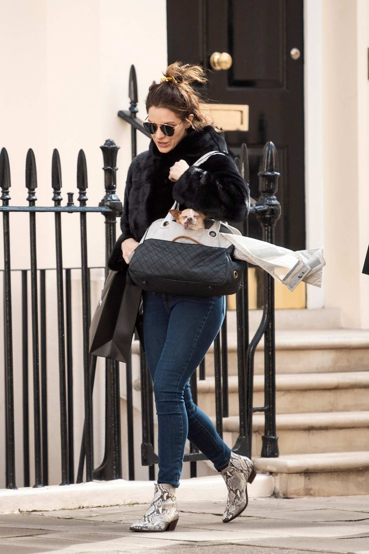 Katharine McPhee wore a black fur coat, jeans and snakeskin boots during a day of shopping in London, UK