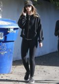 Katherine Schwarzenegger dons an all black ensemble while out for an early walk with a friend in Brentwood, Los Angeles